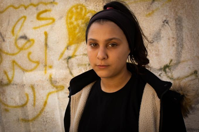 Lulu*, 13, was playing with friends outside in 2014 when an Israeli airstrike hit. 10 of her friends were killed in that explosion and her leg was injured.