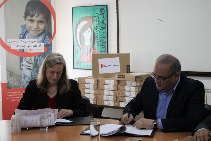 Save the Children oPt Country Director Jennifer Moorehead and the Palestinian Minister of Social Development Dr Ibrahim Shaer sign the MoU