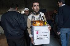 A Palestinian man receives Save the Children food parcel, as part of 2012 Humanitarian Response. 780 food parcels were distributed in the early days of the offensive, serving more than 5460 persons.