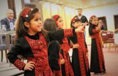 Children aged between 4-6 from Turmus Ayya Kindergarten perform a traditional Palestinian dance.  Teachers from Turmus Ayya Kindergarten were trained through the ECCD programme.
